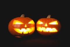 Тыквы хеллоуина усмехаются и страшные глаза на ноча партии Стоковое фото RF