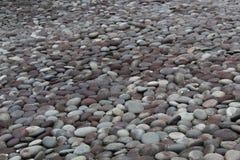 Тысячи черных и серых камней стоковые фото
