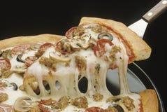 тяга пиццы Стоковое Изображение