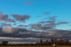 Тяжелые облака захода солнца Стоковое Изображение