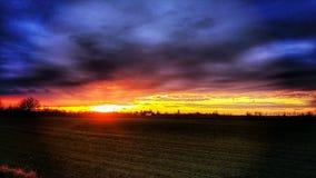 Тяжелый заход солнца Стоковые Изображения