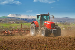 Тractor working on land Stock Photography