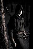 Убийца в глубоком лесе стоковое изображение