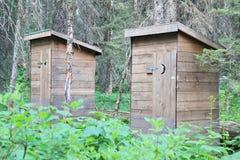 Уборные во дворе в древесинах Стоковое фото RF