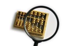 увеличиванное золотистое абакуса Стоковая Фотография