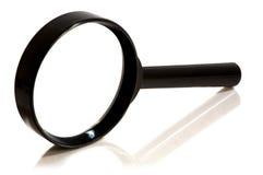 увеличивать предпосылки стеклянный над белизной Стоковое фото RF