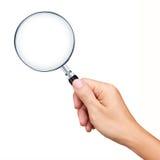 Увеличивать удерживания руки - изолированное стекло Стоковое фото RF