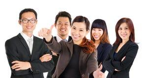 Уверенно азиатская команда дела стоковая фотография rf