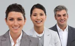 Уверенно бизнесмены стоя совместно Стоковые Изображения RF