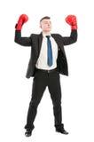 Уверенно бизнесмен действуя как чемпион Стоковая Фотография RF