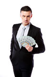 Уверенно бизнесмен держа доллары США Стоковое Фото