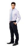 Уверенно бизнесмен с руками в карманн стоковое изображение