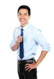 Уверенно молодой бизнесмен указывая на вас стоковая фотография