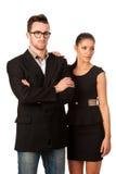 Уверенно пары дела стоя рядом друг с другом Пастбище женщины Стоковое фото RF