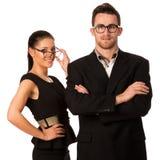 Уверенно пары дела стоя рядом друг с другом Уборная женщины Стоковая Фотография RF