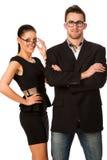 Уверенно пары дела стоя рядом друг с другом Уборная женщины Стоковое Изображение RF