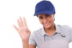 Уверенно повышение женского работника, указывая вверх по 4 пальцам показывать Стоковые Изображения RF