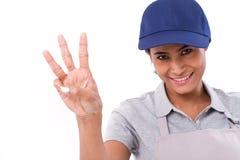 Уверенно повышение женского работника, указывая вверх по 3 пальцам показывать Стоковые Фото