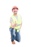 Уверенно построитель вставать и показывая как знак Стоковая Фотография RF