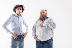 Уверенно тонкий и толстый представлять людей стоковое фото rf