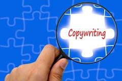 Увеличитель и головоломки слова Copywriting Стоковое Изображение