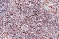 Увяданная красная текстура прессованной древесины Стоковые Фото