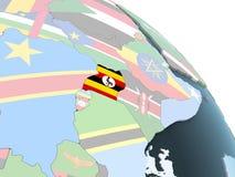 Уганда с флагом на глобусе иллюстрация штока