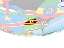 Уганда с флагом на глобусе иллюстрация вектора