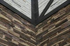 Угловая структура дома Текстура - искусственное façade декоративного камня текстура предпосылки каменной стены серого цвета груб Стоковое Изображение
