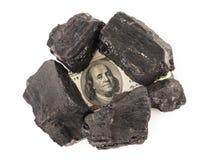 Уголь и деньги стоковая фотография