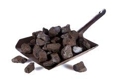 Уголь на лопаточной кости изолированной на предпосылке Стоковое Изображение RF