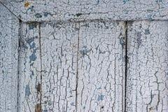 Угловая деталь старой двери с текстурой краски поверхности grunge Стоковое фото RF