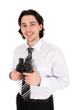 удерживание бизнесмена биноклей Стоковая Фотография