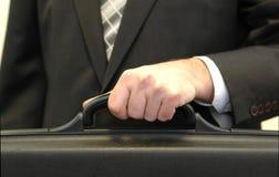 удерживание бизнесмена портфеля Стоковое Изображение RF