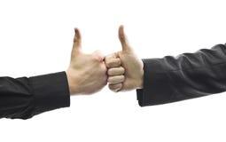 удерживание бизнесмена thumbs 2 вверх Стоковые Фотографии RF