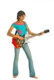 удерживание гитары смотря серьезно стоковое изображение