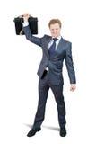 удерживание кратко случая бизнесмена счастливое Стоковое Изображение RF