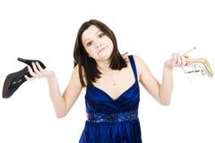 удерживание обувает женщину Стоковые Фотографии RF
