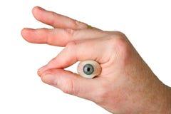 удерживание руки глаза стеклянное Стоковая Фотография RF