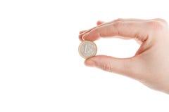 удерживание руки евро монетки женское Стоковые Фото