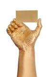удерживание руки карточки золотистое Стоковая Фотография RF