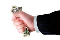 удерживание руки наличных дег бизнесмена Стоковое Изображение