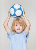 удерживание футбола мальчика Стоковая Фотография RF