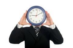 удерживание часов бизнесмена Стоковые Изображения RF