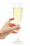 удерживание шампанского стеклянное стоковое фото rf