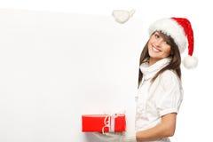 удерживание santa девушки подарка афиши Стоковая Фотография