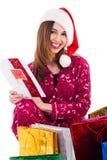 удерживание santa девушки рождества карточки Стоковые Изображения