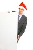 удерживание santa шлема бизнесмена афиши пустое Стоковое фото RF