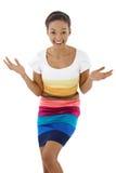 Удивленная смеясь над этническая девушка Стоковое Фото