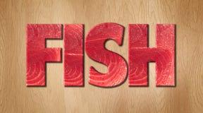 Удите слово предусматриванное в текстуре сырых рыб на деревянной разделочной доске Стоковое Изображение